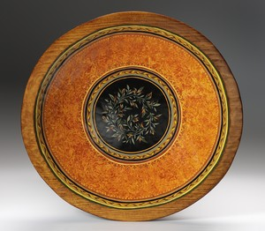 terra cotta and black hadn painted carved wood bowl